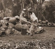 "Final stages in the ""open field firing"" of terracotta storage vessels. The women in both Arigidi and Erusu (In the Akoko area) employ only ""upside down contruction"". Their pottery skills are unique to this region of Yorubaland.  Photo by Ron du Bois, 1988."