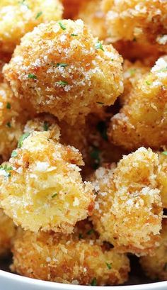 Parmesan Cauliflower Bites - Baked on parchment at 375 instead of frying and used garlic powder, onion powder, and chili powder instead of Emeril's Creole seasoning.