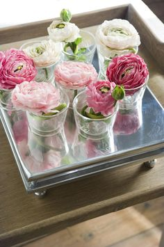 Little vases with pink ranunculus