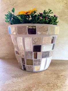 A personal favorite from my Etsy shop https://www.etsy.com/listing/468588578/large-flower-pot-mosaic-planter-handmade