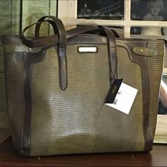 Sale!! Adrienne Vittadini workbook tote New with tags. Beautiful and unique. Could be used as everyday bag or business travel. Padded sleeve for tablet/workbook. Large main compartment. Top zipper closure. Interior organization. Soft PU construction. Shoulder straps. Military green and brown. Adrienne Vittadini Bags