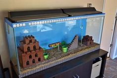 This Lego Super Mario Bros aquarium is the coolest aquarium of all time. The underwater Mario levels were always the most fun: Lego Super Mario, Lego Mario, Super Nintendo, Super Mario Brothers, Super Mario Bros, Legos, Cool Fish Tanks, Game Room Design, Gamer Room