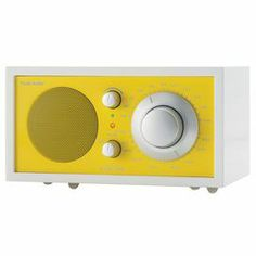 Offering high-fidelity sound in a sleek, modern design, this charming wood radio features a hand-lacquered cabinet, silver knobs, and a vibrantly colored faceplate.  Product: RadioConstruction Material: Wood      Color: Frost white and sunflower yellow    Features:   Tuner brings clarity to many of the weakest stations    Handmade    External FM antenna and 9' power cord included   Frequency contouring circuit automatically adjusts output over half-octave increments   Musically accurate ...