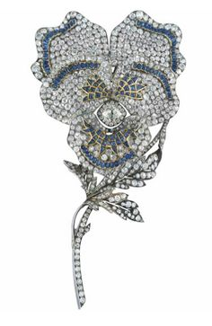 A LARGE LATE 19TH CENTURY SAPPHIRE AND DIAMOND BROOCH.  Modelled as a pansy, the old-cut diamond centre to a pavé-set diamond five petal surround with buff-top and cabochon sapphire accents, raised on a diamond stem with curling leaf detail, mounted in silver and gold, circa 1890
