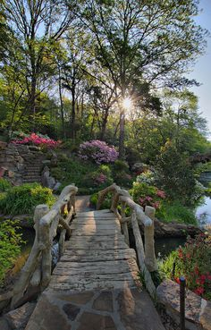 Rustic footbridge to azalea garden at the Old Mill in North Little Rock, Arkansas, USA (by