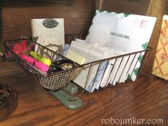 This is a real simple project. I just took an old dish rack and re-purposed it into a desk organizer. Bills, papers and files fit nicely where plates once rested. And Pens and Pencils have taken the place of flatware.