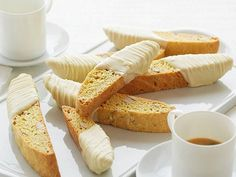 Get Giada De Laurentiis's Almond and Lemon Biscotti Dipped in White Chocolate Recipe from Food Network