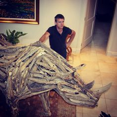 Bryan Cusack with his driftwood Black Rhino which was sold to iThanda Game Reserve in Zululand.