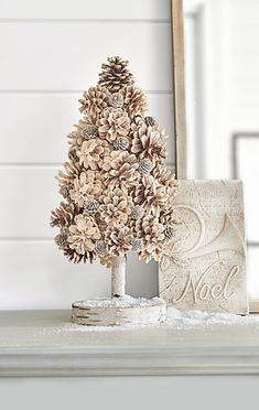 Pinecones of various shapes and sizes come together to make this gorgeous DIY pinecone tree decoration. To make this DIY pinecone project, hot glue large pinecones around a foam cone starting at the top. Fill in any gaps with smaller pinecones. #decoratingwithpinecones #pineconecenterpieces #christmas #diyprojects #decoratingwithpineconesforwinter #bhg