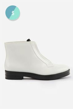 The Shoes You Need To Own Before You Turn 30 #refinery29  http://www.refinery29.com/shoes-every-woman-should-own#slide-4   The Flat Booties A shoe that just works every day is a no-brainer. These white stompers won't slow your hustle (and will keep you blister-free!) without sacrificing style one bit.