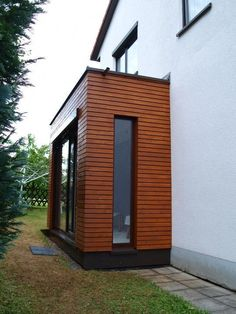 - Windfang Anbau an ein Einfamilienhaus Benefit From The Stylish Look Of Vertical Blinds Article Front Door Porch, Front Porch Design, House With Porch, House Front, Sas Entree, Timber Cladding, House Extensions, House Entrance, Home And Family