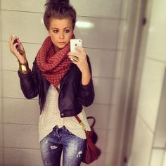 high bun, infinity scarf leather jacket and jeans.