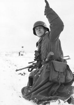 German soldier gives a signal to his men.  Eastern Front, Winter 1944.