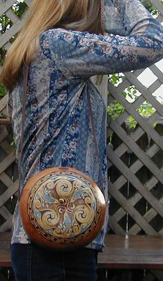 Purse made from a gourd, the artwork is amazing!!.  Just prepping a gourd is hard work!!
