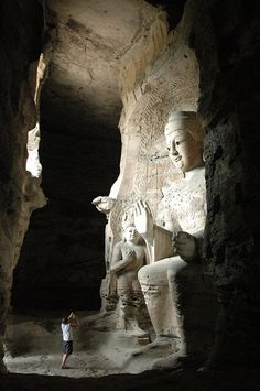 Yungang Grottoes are ancient Chinese Buddhist temple grottoes near the city of Datong. There is colossal statues of Buddha. This picture shows one of the middle sized one.
