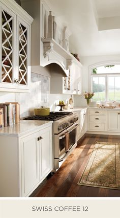 This farmhouse chic kitchen glows with natural lighting thanks to the neutral shade of Swiss Coffee on the walls, trim, and cabinetry. BEHR Paint suggests layering different shades of white to create a cohesive and modern look in your home.