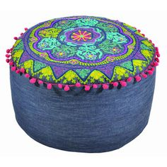 How cool! A denim pouf, now I wish I hadn't donated my old jeans, I would love to make one of these!!