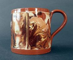 Mochaware mug with surface agate slip, early 19th century, Staffordshire.