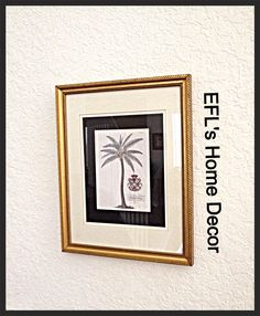My home decor framed palm tree art from Goodwill.  I saw great potential in this picture, but didn't like the cheap mat.  My husband replaced the mat with an in expense may from Wal-mart and here you go.  EFL
