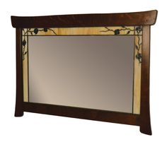Pasadena Horizontal Mirror: This beautiful mirror features hand crafted art glass border of amber, purple flowers, and green leaves. Assembled using copper foil method. DISCONTINUED ITEM.