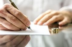 Signing divorce papers - Gajus/Getty Images