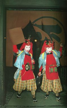 """Maiko w Oni masks dressing for Setsubun - scan from """"Gion"""" book. Note an old-school radio in her hand .)"""