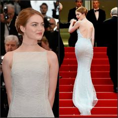 Emma Stone looks beautiful in a pale blue open back lace Christian Dior Couture Gown Cannes2015