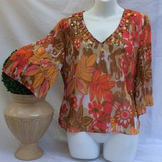Daisy Fuentes Blouse Multi-color v-neck cut in front with beautiful beads. Daisy Fuentes Tops Blouses