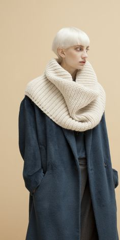 Heavy-gauge knit blended from Italian alpaca yarns composes a substantial snood perfect for throwing over your favorite dress, jacket or tee no matter what the weather throws at you.  A partially split back ensures an easy fit whether you bundle your snood high around the neck or drape it over and down the shoulders. Textile from Italy. Made in New York. One of our favorite picks from Schai that you are guaranteed to get maximum mileage from. #fashion #style #accessories #fall