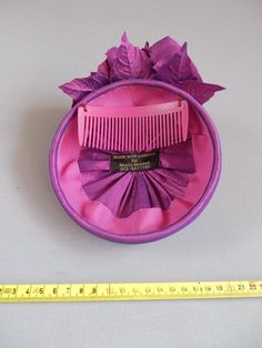 Handmade changeant cyclaam blue silk minihat on comb from Tocados  Redecilla 6772ddbaeaa
