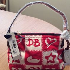 Authentic Dooney & Bourke Pouchette Red & White Dooney & Bourke Pouchette. 2 inside pockets (1 zip & 1 cell phone) also inside keychain clip. **Brand new with tags** {Cheaper price on Mercari} Dooney & Bourke Bags Mini Bags