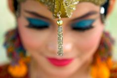 Indonesian greeter from The Amazing Race Amazing Race, Racing, Culture, Poses, Drop Earrings, Photography, Events, Inspirational, Jewelry