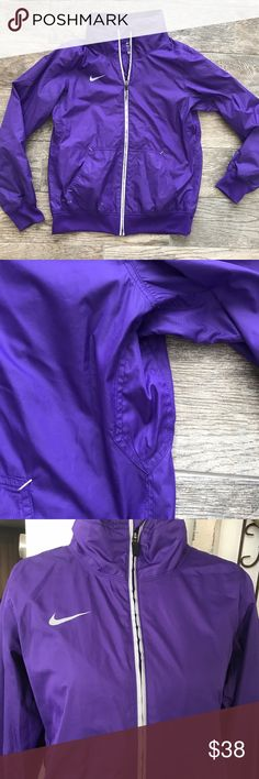 Nike Storm Fit Purple Jacket Nike Storm Fit Purple Jacket - Size medium. There is a tiny hole (picture #7) in the sleeve of the right side (when being worn), other than that, this jacket is in great condition. Lots of life still! Nike Jackets & Coats