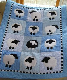 Sheepzzz Baby Quilt. 35 x 45 in. Black sheep in the bunch for a touch of whimsy. Machine appliqued.