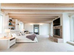 3rd floor #masterretreat with fireplace and #spalikebathroom.  See the wooden beams?  Beautiful.