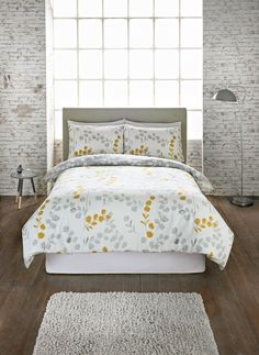 This reversible blossom print duvet cover is perfect for any modern or contemporary bedroom. The front is a cream base with ochre and grey petals whilst the... Polycotton Fabric, Duvet Sets, Matalan, White Duvet Covers, Contemporary Bedroom, Floral Prints, Pillow Cases, Comforters, Grey