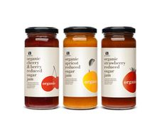 Left aligned text, repetition in the text positioning, typeface, and fruit image, though fruit is different on each jar.