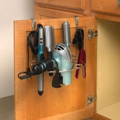Organize your hair-care tools with Spectrum's Shapes™ Over the Cabinet Door Styling Rack. Great for bathroom clutter-control, this organizer easily slides over standard cabinet doors to keep all your essential hair styling tools conveniently at your fingertips. Made of sturdy steel, the unique Shapes™ design neatly stores flat irons, curling irons, hair brushes and hair dryers with nozzles up to three-inches wide. Also features two hooks and storage space to hang cords or other hair ...