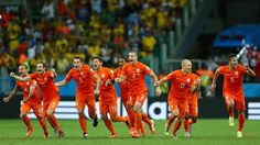 SALVADOR, BRAZIL - JULY 05: Wesley Sneijder, Daley Blind, Stefan de Vrij, Klaas-Jan Huntelaar, Jeremain Lens, Ron Vlaar; Arjen Robben and Robin van Persie of the Netherlands celebrate victory in a penalty shootout against Costa Rica during the 2014 FIFA World Cup Brazil Quarter Final match between the Netherlands and Costa Rica at Arena Fonte Nova on July 5, 2014 in Salvador, Brazil. (Photo by Michael Steele/Getty Images)