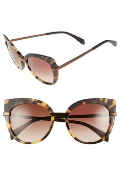 Logo-etched temples lend subtle signature style to these striking two-tone sunglasses cast in a modified cat's-eye silhouette—for a look that seamlessly merges retro and modern sensibilities.