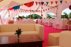 Comfortable seating area in the Capri Marquee wedding next to the River Thames.