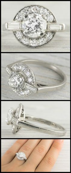 Antique Art Deco engagement ring with a 1.19 carat old European cut center stone set within a wide halo of circular cut diamonds with delicate millegrain edges and two baguette diamonds. Via Diamonds in the Library.