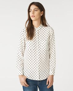 Polka dot shirt cut from soft silk. Long sleeves, button cuffs, patch pockets and a neat point at the collar for a tidy finish. Wear this piece day or night for a polished look.