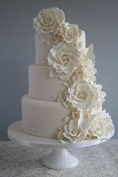 {Gorgeous}  Bloomed roses and butterflies cascade down a champagne fondant cake with vintage lace detail.    We love cakes @ www.artisanbakeshop.com