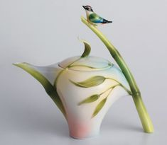 Bird on Bamboo Teapot: A songbird perching on bamboo serves as the handle for this exquisite Franz hand crafted porcelain teapot. The detailed painting and interesting shape of the piece makes it a work of art.
