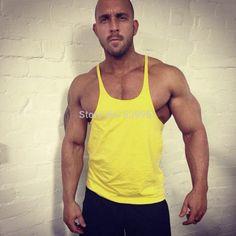 Bodybuilding Fitness Men Sleeveless Gym Singlet Tank. Item Type: TopsTops Type: Tank TopsGender: MenPattern Type: SolidStyle: NoveltyFabric Type: BroadclothHooded: NoMaterial: CottonCollar: O-NeckStyle: Active SIZE CHART    Size Cross Shoulder(cm) Chest Width(cm) Body Length(cm) Sleeve Length(cm) Height Range(cm) Weight Range(kg)     S Free 90 68 Free 170 68   M Free 96 70 Free 175 78   L Free 102 72 Free 180 85   XL Free 108 74 Free 185 95   XXL Free 114 76 Free 190 105