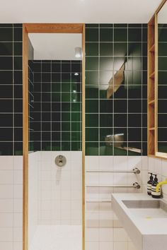 A similar green tile features in the main bathroom – the idea was to reference the Victorian glazed tiles that are common in the area. Concrete Column, Concrete Ceiling, Warehouse Apartment, London Apartment, Green Kitchen Inspiration, Low Sideboard, Ceiling Shelves, Architects London, Sliding Pocket Doors