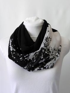 727c9b22b09 This black and white infinity scarf is the perfect accessory to complete  your outfit! Its