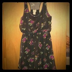 NWT Eyelash Black Floral Sheer Sleeveless Dress *This is a super cute NWT dress! I bought but never wore.* * Pretty sheer look but lined for you already! *  Brand: Eyelash Size: L (And fits pretty true in my opinion!) Color: Black with purple, pink, and blue roses Sleeveless with a round neckline. Eyelash Dresses