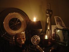 Ancestor Altar - themes of time, death & mystery. The pictures here are of my tradition ancestors. #wiccan #pagan